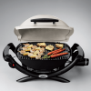Weber Baby Q™ 1000 with food on grill