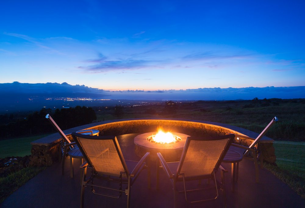 A fire pit overlooking a sunset