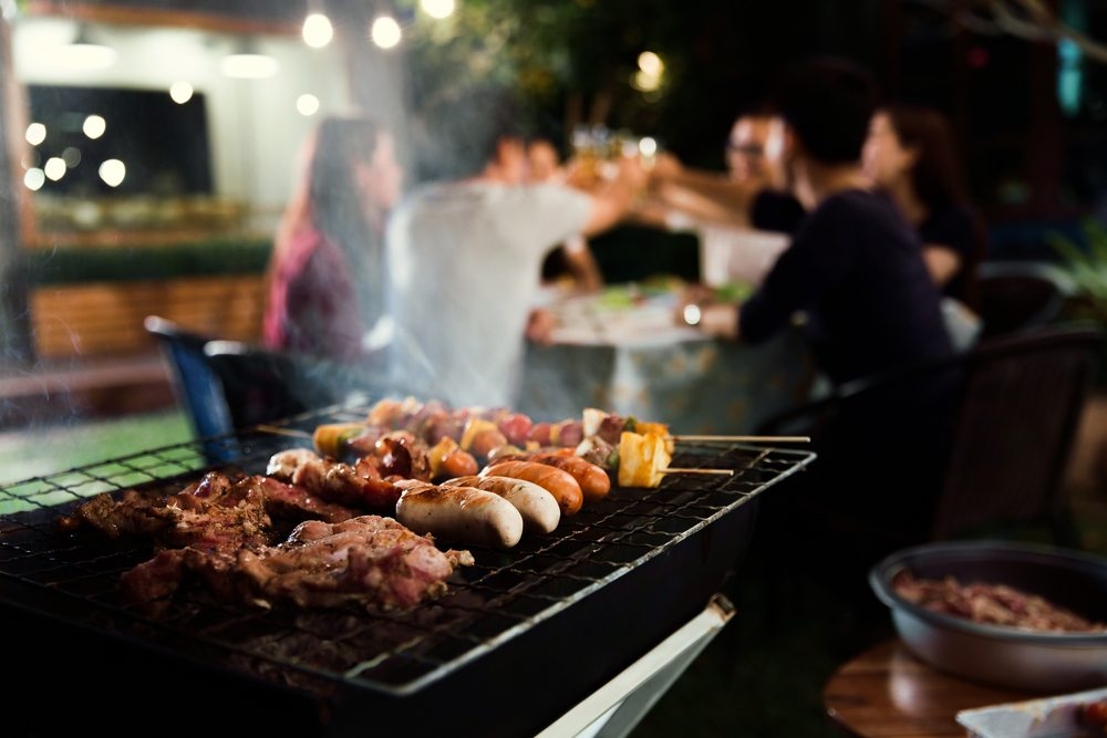 A dinner party near a bbq at night