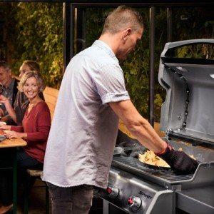 friends sitting outside and enjoying bbq on weber bbq